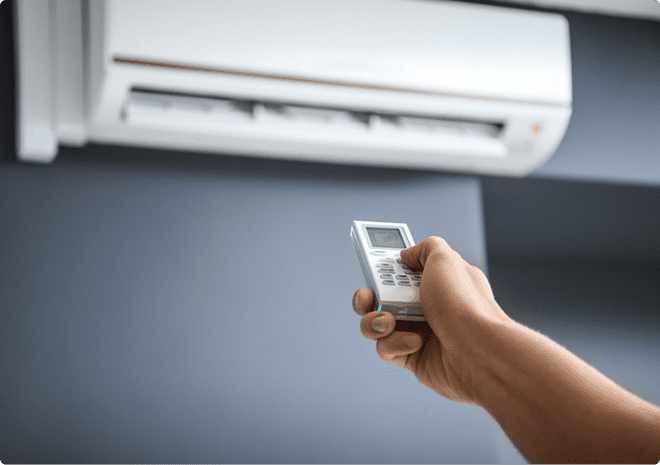 hand holding a remote pointing it at a heat pump in a home